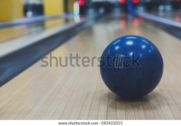 Bowling accessories background. Interior of bowling alley, lane with ball closeup, selective focus