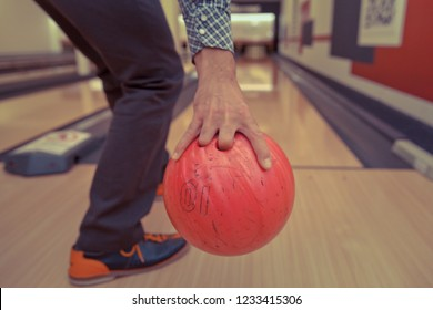 bowling ball in action with a game of bowling in sports center