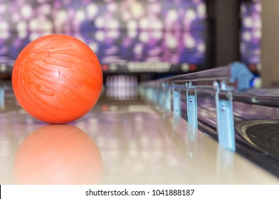 bowling ball certain to hit the target, thanks to the bumper rails preventing it to roll in the gutter