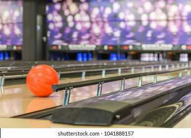 bowling ball rolls in between of the bumper rails, certain to hit target