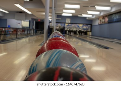 Bowling Balls are aligned for a small improvised tournament in the town of Waka, Canada
