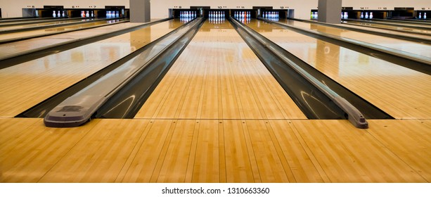 Bowling balls and wooden lane.