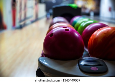 Bowling balls and wooden lane in bowling hall. Leisure concept