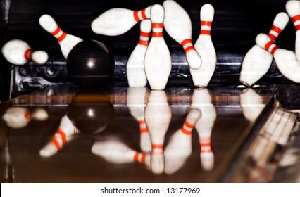 Bowling Game. A ball hitting the pins.