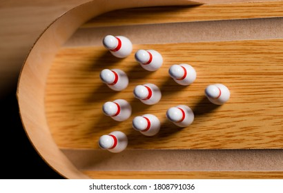 Bowling game indoors with pins or skittles