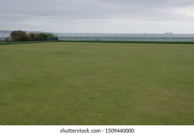 Bowling Green with a Freight Ship in the Background Overlooking Mounts Bay on the English Channel in the Seaside Town of Penzance in Cornwall, England, UK
