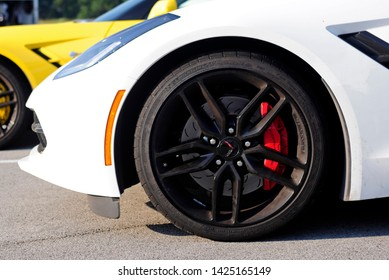 BOWLING GREEN, KY - JUNE 16, 2018: The Michelin tire and front brakes of a white Corvette are seen at the National Corvette Museum Motorsports Park in Bowling Green, Kentucky.