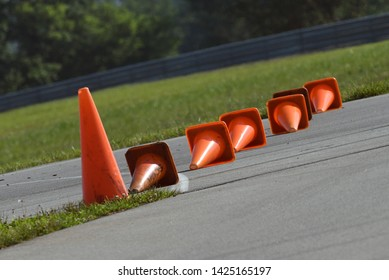 BOWLING GREEN, KY - JUNE 16, 2018: Traffic cones are lined up on the racing surface at the National Corvette Museum Motorsports Park in Bowling Green, Kentucky.