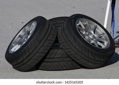 BOWLING GREEN, KY - JUNE 16, 2018: Four Hankook tires are seen in a pile at the National Corvette Museum Motorsports Park in Bowling Green, Kentucky.