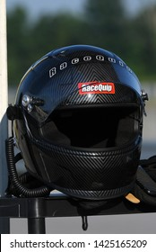BOWLING GREEN, KY - JUNE 16, 2018: A RaceQuip helmet sits on a pit box at the National Corvette Museum Motorsports Park in Bowling Green, Kentucky.