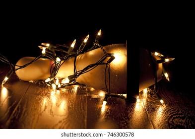 Bowling pin with Christmas lights strung around it. Calgary, Alberta, Canada.