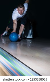 bowling player makes a blue ball move, close-up