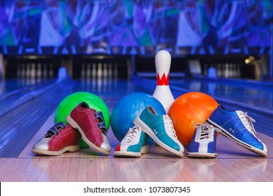 bowling shoes, bowling pins and ball for play in bowling