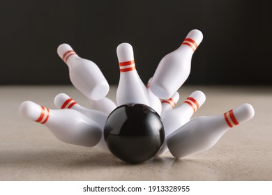 Bowling strike hit on dark background. Minimal concept of success and win.
