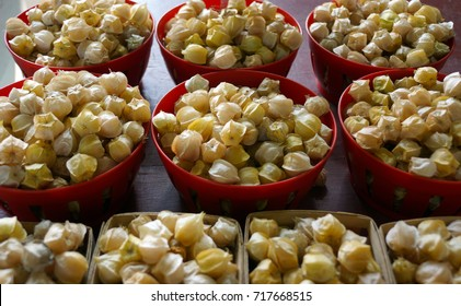 Bowls of cerises de terre (also called ground cherries) at Jean Talon Market, Montreal, Quebec, Canada