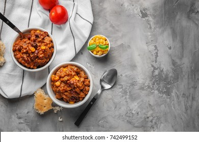 Bowls with chili con carne on table