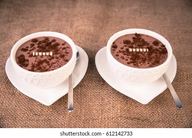 Bowls with chocolate pudding
