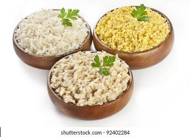 Bowls of cooked cereal  porridge kasha - healthy cereal eating from rice, oatmeal porridge and millet (couscous)