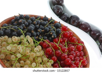 Bowls of currants and cherries.