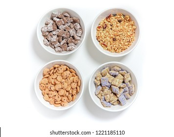bowls of different cereal on a white background. granola, kashi and cereal chocolate chip cookies. flat lay, top view