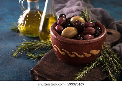 bowls with different kind of olives green , black,  kalamata  on table