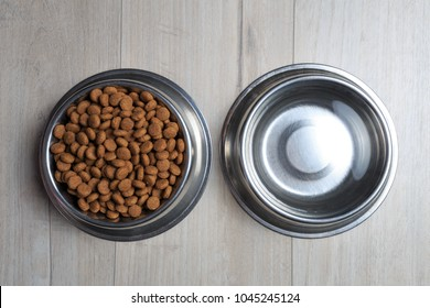 Bowls with dog food and water from above. Dog feed theme.