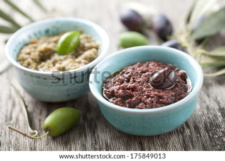 bowls with fresh olive paste made from kalamata olives