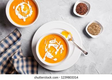 Bowls of homemade organic buttenut squash and pumpkin soup