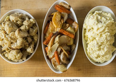 Bowls of Meal Side Dishes of Roasted Potatoes and Root Vegetables and Mashed Potatoes