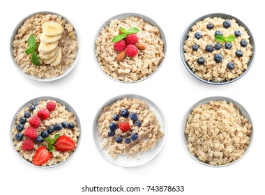 Bowls of oatmeal with berries and fruits on white background