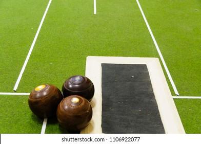 Bowls on an indoor bowls carpet