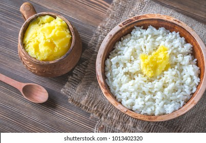 Bowls of rice and Ghee clarified butter
