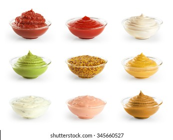 Bowls with sauces ketchup and mustard on white background. Collection.