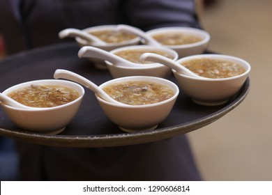 Bowls of shark fin soup being serve in a restaurant in Asia.