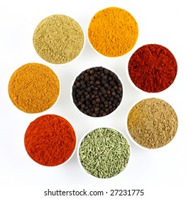 bowls of spices on white background
