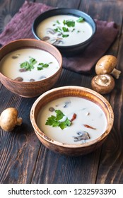 Bowls of thai tom kha soup on the wooden table