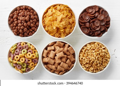 Bowls of various cereals from top view