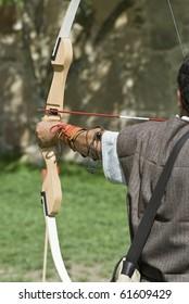 A bowman shooting his bow.