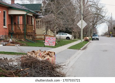 Bowmanville, ON/Canada-April 8, 2020: A residential street in Bowmanville Ontario. A large sign on the lawn urges people to stay home due to COVID-19. Coronavirus warning signs.