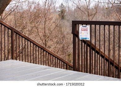 Bowmanville,Ontario/Canada-April,23,2020 Stairs leading down to the Bowmanville creek. There is a Covid-19 Park & Safety sign displayed explaining proper scocial distancing guidlines.