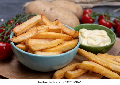 Bown with fresh cooked french fries potato chips with belgian mayonnaise sauce close up