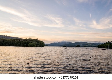 Bowness-on-Windermere, England - August 4, 2018: Panoramic view of  the Sun Sets over Lake WIndermere