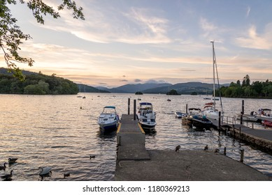 Bowness-on-Windermere, England - August 4, 2018: Panoramic view of Moored Yachts as the Sun Sets over Lake WIndermere
