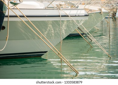 The bows of two luxury yachts moored in the marina at Port d'Andratx, Mallorca, Spain.