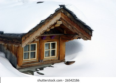 Bow-window of a chalet in a ski resort.