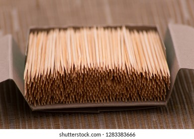 box of bamboo toothpicks on a table set