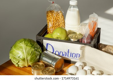 A box with a basic set of food items. Donation food