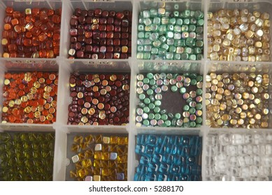 a box with beads in different colors