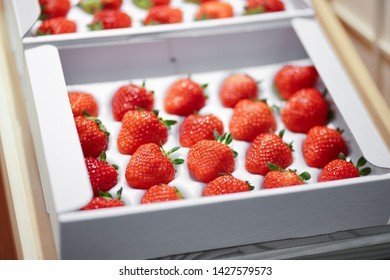 A box of beautiful Japanese strawberries at a super market.