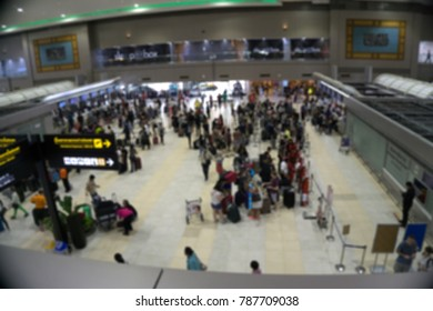 Box Blurred or Defocus image of inside the airport terminal with a group of people in terminal hall for use as Background